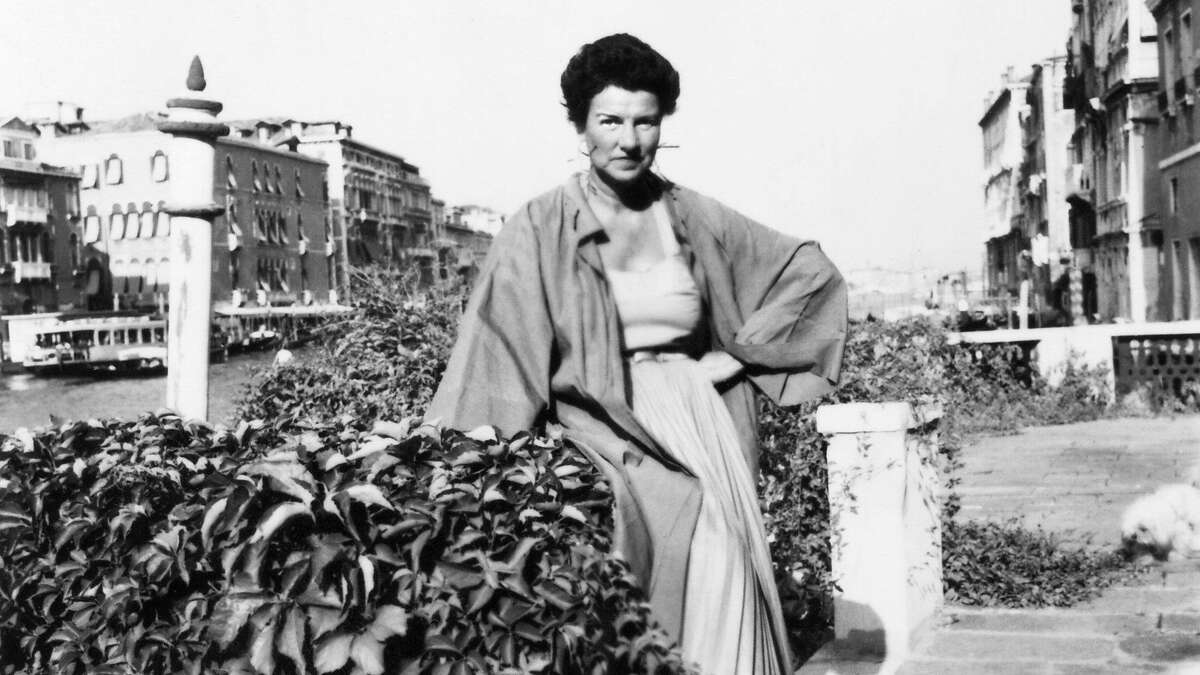 """Peggy Guggenheim on the banks of the Grand Canal in Venice. Guggenheim is the subject of the new documentary """"Peggy Guggenheim: Art Addict,"""" directed by Lisa Immordino Vreeland. Credit: Courtesy of the Peggy Guggenheim Collection Archives, Venice"""