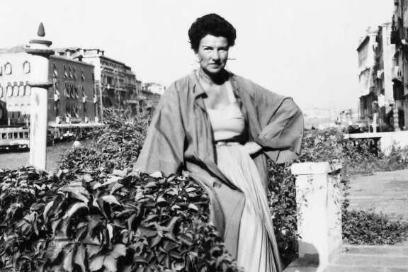 "Peggy Guggenheim on the banks of the Grand Canal in Venice. Guggenheim is the subject of the new documentary ""Peggy Guggenheim: Art Addict,"" directed by Lisa Immordino Vreeland. Credit: Courtesy of the Peggy Guggenheim Collection Archives, Venice"