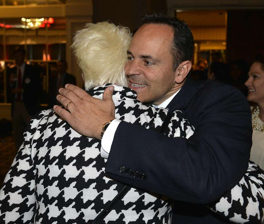 Kentucky Gov.-elect Matt Bevin, who ran as an outsider, receives a hug from one of his supporters. Photo: Timothy D. Easley, Associated Press
