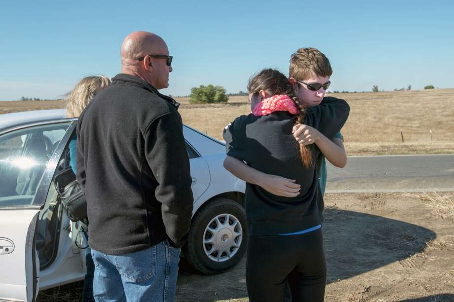 University of California, Merced student Justin Dick, right, hugs his sister Kristen as his parents Beth and Keith look on following a stabbing in Merced, Calif., Wednesday, Nov. 4, 2015. An assailant stabbed five people at the rural university campus in central California before police shot and killed him, authorities said Wednesday. Justin was one of 15 students in the core class where the incident took place Wednesday morning. (Paul Kitagaki Jr.(Paul Kitagaki Jr./The Sacramento Bee via AP)  MAGS OUT; LOCAL TELEVISION OUT (KCRA3, KXTV10, KOVR13, KUVS19, KMAZ31, KTXL40); MANDATORY CREDIT  (REV-SHARE) (ONLN OUT; IONLN OUT - MBI) Photo: Paul Kitagaki Jr., Associated Press / The Sacramento Bee