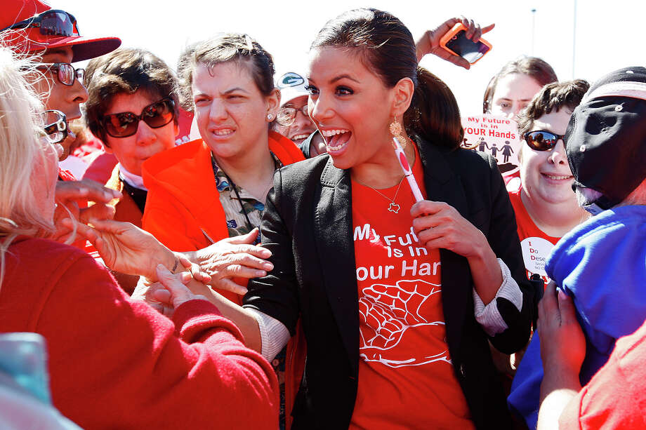 Eva Longoria is rallying for San Antonio's Inspiration Island to win USA Today's 10Best series' Favorite New Attraction competition. Longoria, who has been a longtime supporter of Morgan's Wonderland, greeted supporters during a rally at the park in 2011. Photo: JERRY LARA /SAN ANTONIO EXPRESS-NEWS / glara@express-news.net