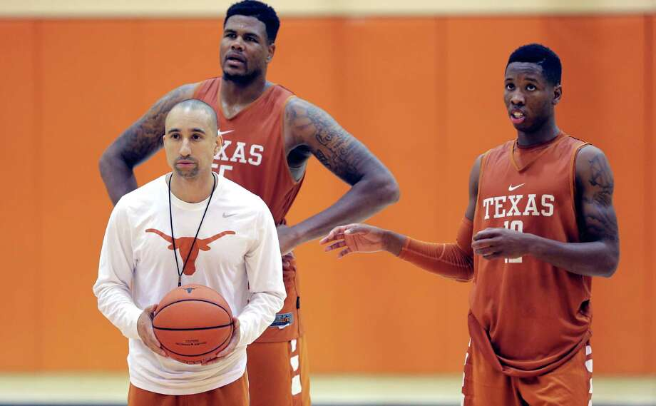 In this Oct. 13, 2015, file photo, Texas head basketball coach Shaka Smart runs drills during a practice at the team's facility as Cameron Ridley (55) and Kerwin Roach, Jr., right, look on, in Austin, Texas. Hired in early April, Smart has had several months to settle into his new environment and size up his roster and he prepares to bring his up-and-down-the-court style to the rugged Big 12.(AP Photo/Eric Gay) Photo: Eric Gay, STF / Associated Press / AP