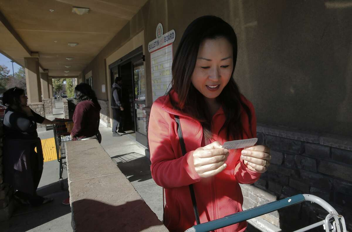 MIichaella Hwang checks her shopping list before going into the 99 Ranch Market in Pleasanton, Calif. on Wed. November 4, 2015. The market tops a list of those who have violated the city's excessive water use policy.