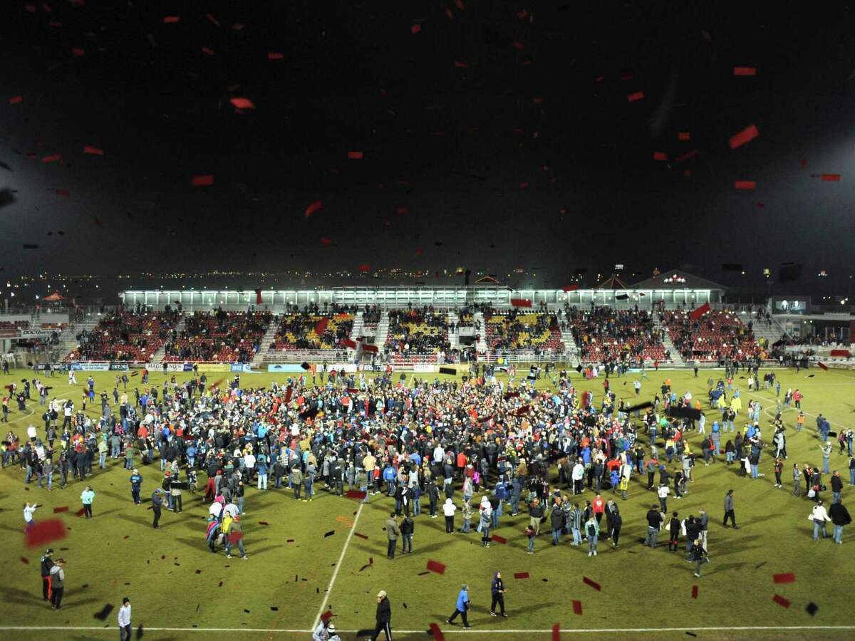 Fans storm the field in celebration after the San Antonio Scorpions won the NASL Championship Final against the Ft. Lauderdale Strikers at Toyota Field on Saturday, Nov. 15, 2014.