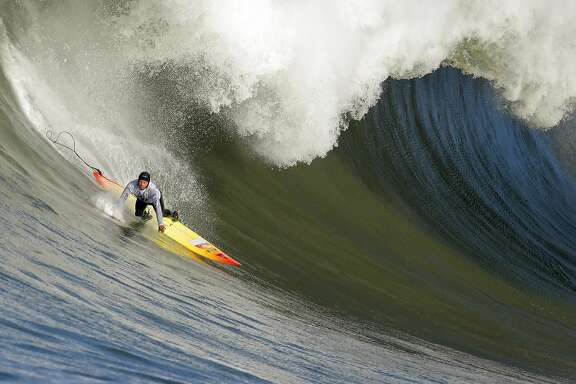 """Darryl """"Flea"""" Virostko wipes out in the first heat. Surfers from around the globe braved the 50-foot-high swells at Mavericks Surf Contest in Half Moon Bay, Calif., on Saturday, February 13, 2010. Chris Bertish of South Africa was selected the winner."""