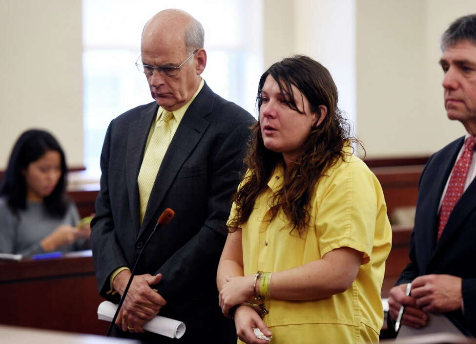 Defendant Sara Moore received a sentence of 25 years to life from Judge Stephen Herrick Tuesday morning Oct. 14, 2014 in Albany County Court in Albany, N.Y. for the murder of a 79-year-old man that she was caring for. She was represented by Attorney Stephen Coffey, left, at the sentencing. (Skip Dickstein/Times Union)