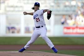 FILE - In this Oct. 16, 2015, file photo, Los Angeles Dodgers starting pitcher Zack Greinke works against a New York Mets batter during the first inning in Game 5 of baseball's National League Division Series in Los Angeles. The NL Cy Young Award contender Greinke could opt out of his contract to seek bigger riches on the free agent market. (AP Photo/Gregory Bull, File)