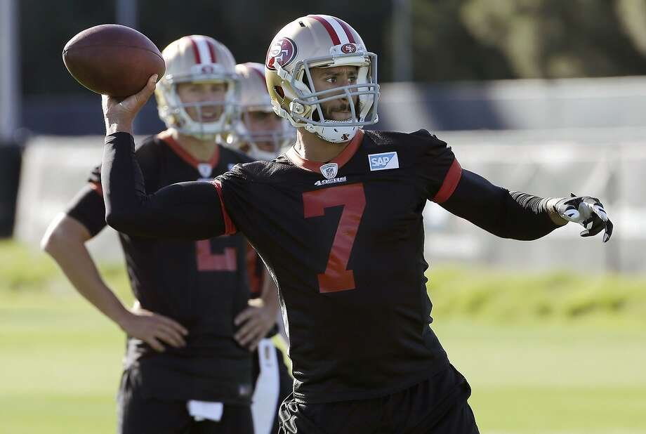 The backup quarterback — Blaine Gabbert (rear) — has become the starter as the 49ers have decided to bench Colin Kaepernick. But coach Jim Tomsula has refused to commit to Gabbert beyond this week's game against Atlanta. Photo: Jeff Chiu, Associated Press