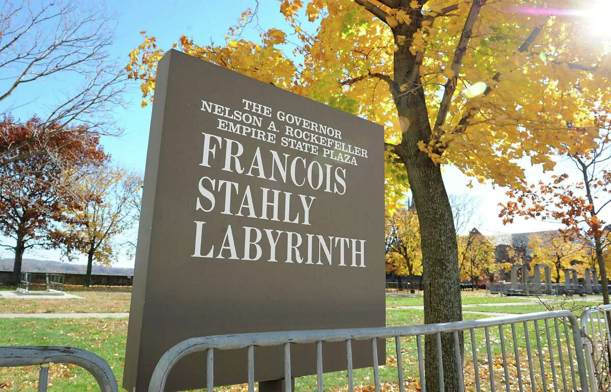 """Sign at Francois Stahly's monumental sculpture """"Labyrinth"""" at the Empire State Plaza on Wednesday, Nov. 4, 2015 in Albany, N.Y. Workers were dismantling the piece of art as part of a year-long restoration effort of the 1971 installation that was part of Gov. Rockefeller's Modern Art collection. (Lori Van Buren / Times Union)"""