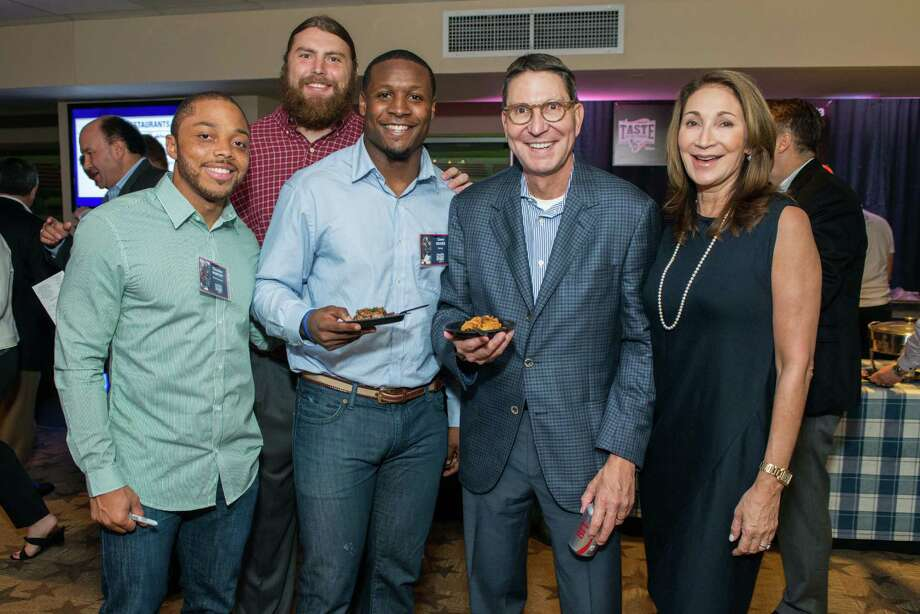 Chandler Worthy, Eric Tomlinson, Corey Moore with Taste of the Texans honorary chair Scott McClelland and wife Soraya McClelland. Taste of the Texans Photo: Taste Of The Texans, Photographer / Owner / © 2015 Michelle Watson. All rights reserved.