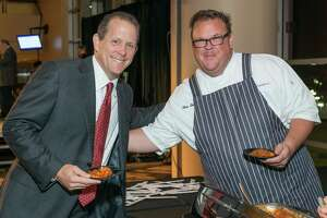 Texans president Jamey Rootes with Underbelly chef Chris Shepherd  at the Taste of the Texans. Taste of the Texans