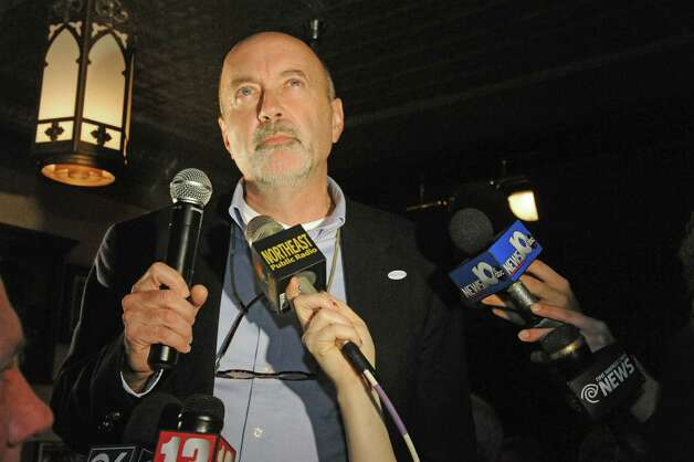 Patrick Madden, center, speaks to supporters as he declares victory in the Troy Mayoral race at ryan's Wake on Tuesday Nov. 3, 2015 in Troy, N.Y. (Michael P. Farrell/Times Union) ORG XMIT: MER2015110322533993 Photo: Michael P. Farrell / 00034032A