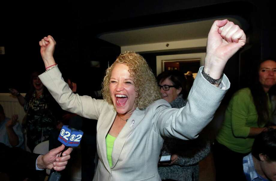 Former state lawmaker Jackie Biskupski reacts as results come in Tuesday at her election night party for Salt Lake City mayor. Biskupski is poised to narrowly defeat incumbent Ralph Becker in the mayor's race and would be the city's first openly gay leader if elected. Photo: Rick Bowmer, STF / AP