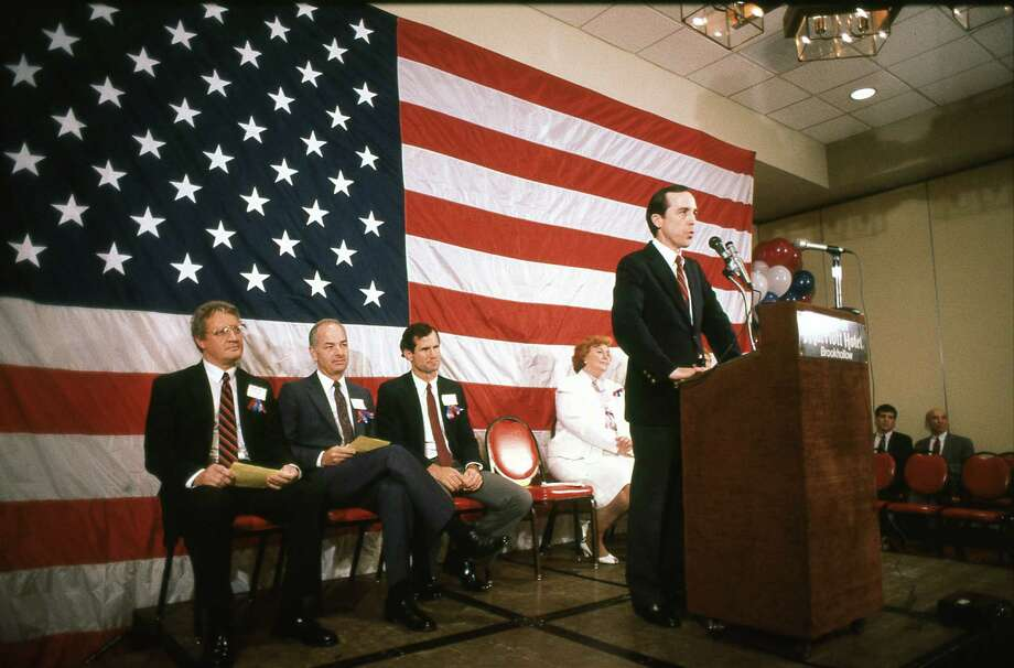 July 18, 1985: At a Straight Slate rally, candidates O.J. Striegler, Jim Kennedy, Charles Carter and Margaret Hotze listen to Steven Hotze, the Straight Slate campaign chairman. Photo: Andy King, © Houston Chronicle / Houston Post files