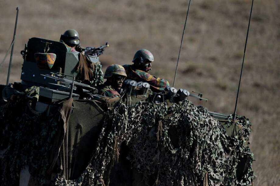 When it comes to military slang, sometimes things get lost in translation for civilians. Click the slideshow to see if you can you guess what these military terms mean. Photo: Abraham Caro Marin, STR / AP