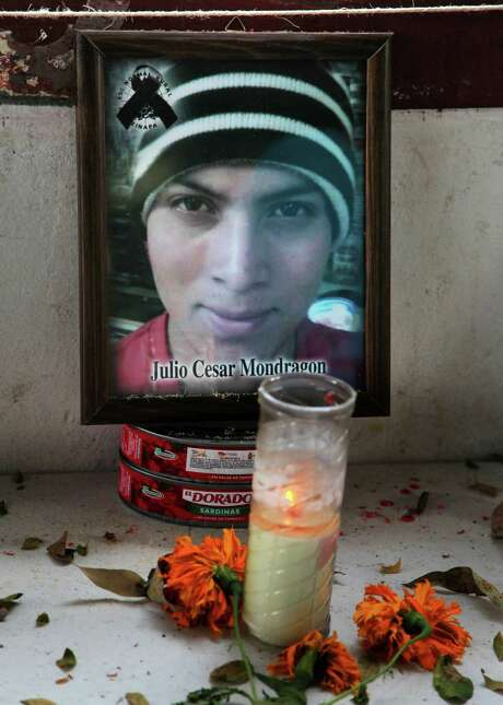 FILE - In this Nov. 9, 2014 file photo, an altar for slain student Julio Cesar Mondragon stands at his former school, the Raul Isidro Burgos Rural Normal School of Ayotzinapa, in Tixtla, Mexico. On Wednesday, Nov. 4, 2015, experts are exhuming the body of Mondgragon who was found dead with his face skinned off a day after 43 of his colleagues disappeared on Sept. 26, 2014 at the hands of police and a drug gang. (AP Photo/Marco Ugarte, File) Photo: Marco Ugarte, STR / AP