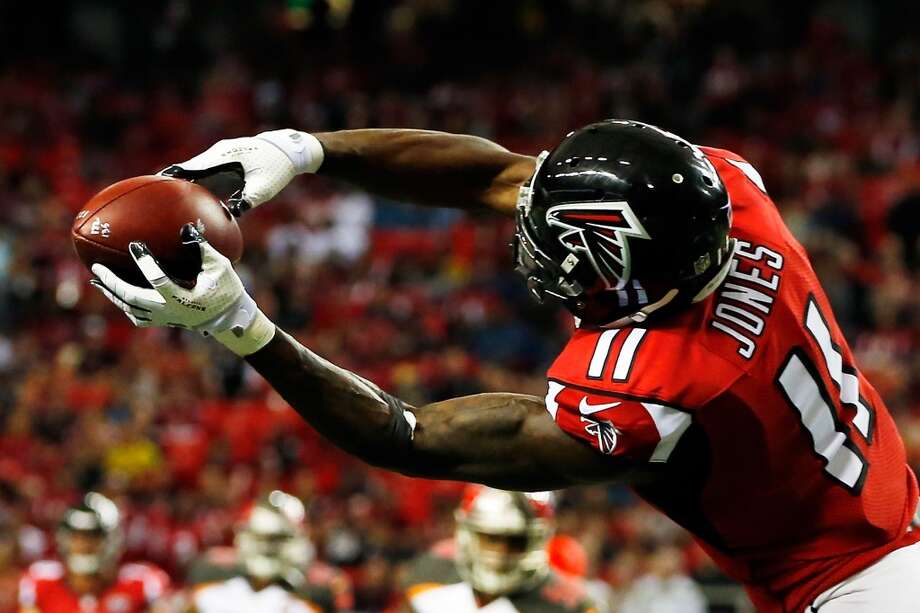 Atlanta FalconsJulio Jones will become the first receiver to top 2,000 yards. He only fell 129 yards shy last season. Photo: Kevin C. Cox, Getty Images