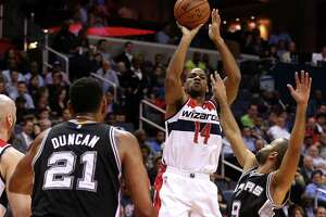 WASHINGTON, DC - NOVEMBER 04: Gary Neal #14 of the Washington Wizards shoots in front of Tony Parker #9 of the San Antonio Spurs during the first half at Verizon Center on November 4, 2015 in Washington, DC. NOTE TO USER: User expressly acknowledges and agrees that, by downloading and or using this photograph, User is consenting to the terms and conditions of the Getty Images License Agreement.