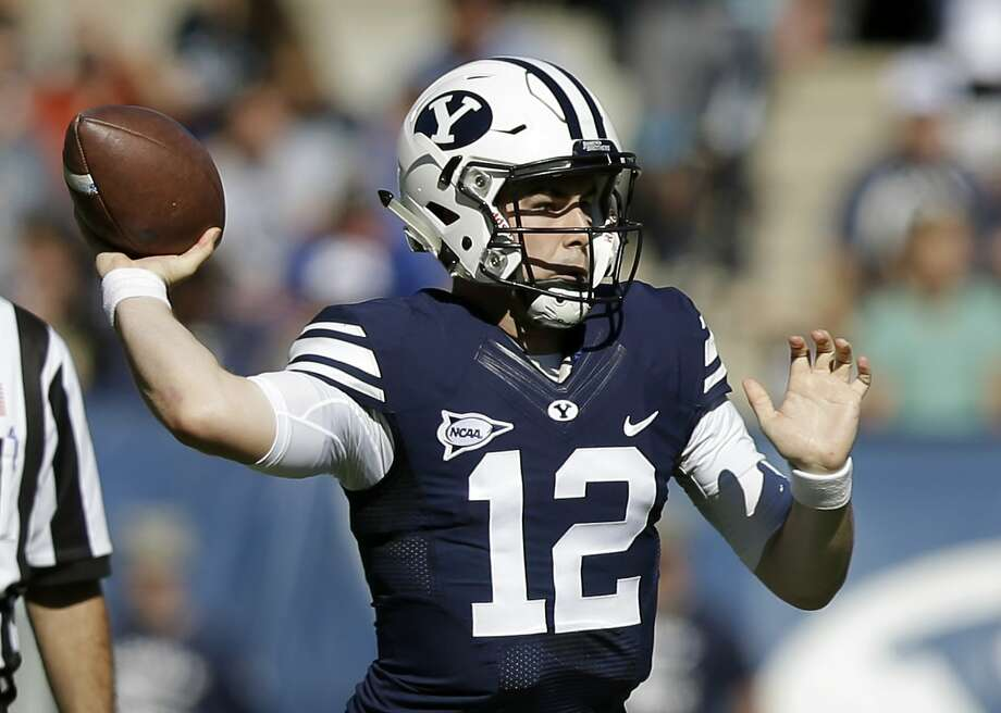 BYU quarterback Tanner Mangum (12) passes the ball in the first half during an NCAA college football game against Wagner Saturday, Oct. 24, 2015, in Provo, Utah. (AP Photo/Rick Bowmer) Photo: Rick Bowmer, Associated Press