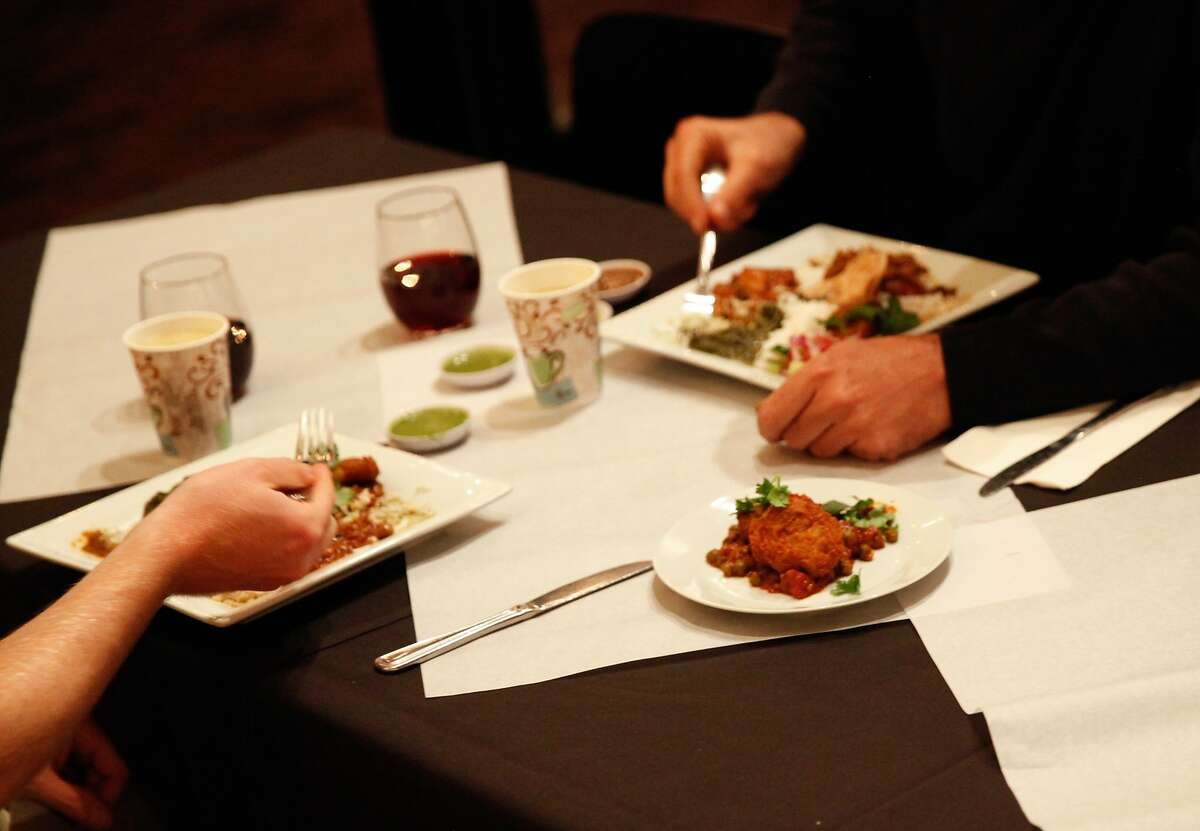 Diners eat Indian food at a pop-up dinner at the LionFish SupperClub at the Food Lounge in Santa Cruz, Calif., on Tuesday, November 3, 2015.