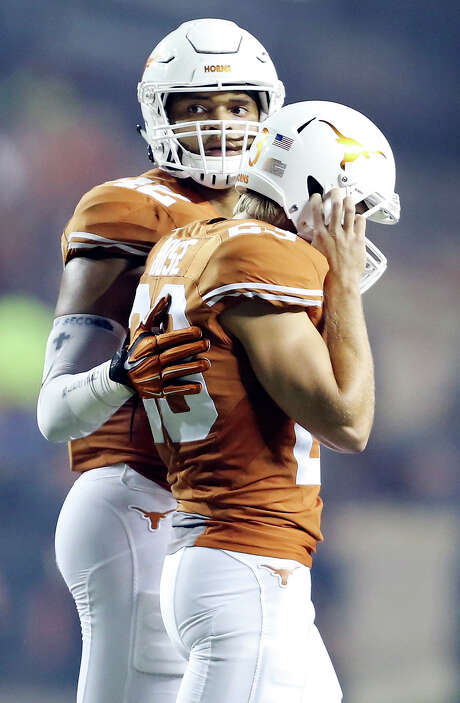 Longhorns tight end Caleb Blueiett, left, consoled Nick Rose after he went from being known for viral video kicking feats to missing an extra point that sealed a loss to California earlier this season. Photo: Edward A. Ornelas, Staff / Â 2015 San Antonio Express-News