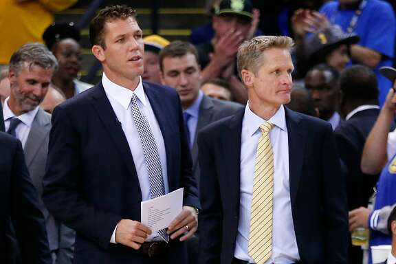 OAKLAND, CA - OCTOBER 27:  (L-R) Interim head coach Luke Walton and head coach Steve Kerr of the Golden State Warriors stand by the bench prior to the NBA season opener at ORACLE Arena on October 27, 2015 in Oakland, California. NOTE TO USER: User expressly acknowledges and agrees that, by downloading and or using this photograph, User is consenting to the terms and conditions of the Getty Images License Agreement.  (Photo by Ezra Shaw/Getty Images)