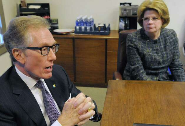 Gary Crosby, CEO of First Niagara Financial Corp, and Beth Mooney, CEO of Key Corp, talk about the impact of their merger at the Palace Theater on Wednesday Nov. 4, 2015 in Albany, N.Y.  (Michael P. Farrell/Times Union) Photo: Michael P. Farrell / 00034058A