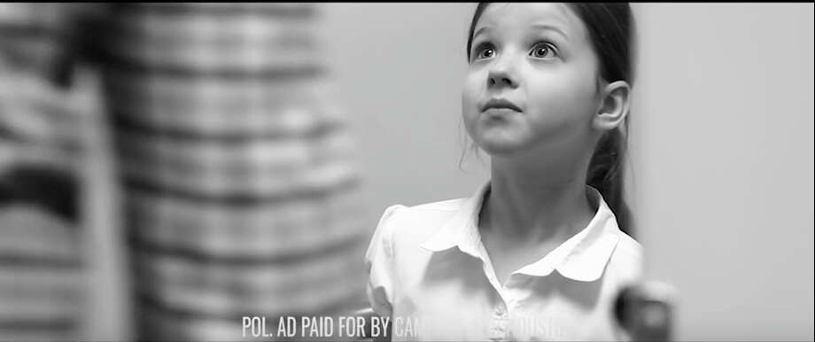 A frame grab from an anti-HERO ad shows a little girl being confronted by a strange man in a restroom. / Campaign for Houston