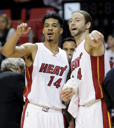 Miami Heat guard Gerald Green (14) and forward Josh McRoberts (4) talk on the sideline during a timeout in the first half of an NBA preseason basketball game against the Washington Wizards, Wednesday, Oct. 21, 2015, in Miami. (AP Photo/Alan Diaz) Photo: Alan Diaz, STF / AP