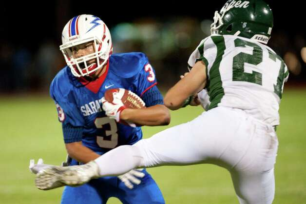 Saratoga's Ryan Manlapaz, left, avoids a tackle from Shenendehowa's Richard Drum during their football game on Friday, Sept. 25, 2015, at Saratoga Springs High in Saratoga Springs, N.Y. (Cindy Schultz / Times Union) Photo: Cindy Schultz / 10033490A