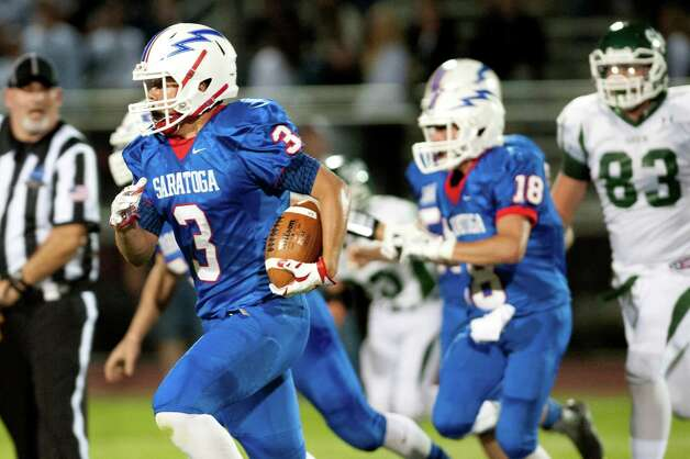 Saratoga's Ryan Manlapaz, left, returns the ball for a touchdown during their football game against Shenendehowa on Friday, Sept. 25, 2015, at Saratoga Springs High in Saratoga Springs, N.Y. (Cindy Schultz / Times Union) Photo: Cindy Schultz / 10033490A