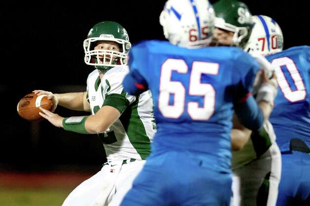Shenendehowa's quarterback Eric Morris, left, gets pressured as he looks to pass during their football game against Saratoga on Friday, Sept. 25, 2015, at Saratoga Springs High in Saratoga Springs, N.Y. (Cindy Schultz / Times Union) Photo: Cindy Schultz / 10033490A