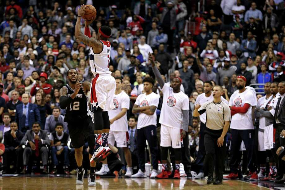 Washington's Bradley Beal rises for the game-winning shot before LaMarcus Aldridge can get a hand up Wednesday night. Photo: Patrick Smith / Getty Images / 2015 Getty Images