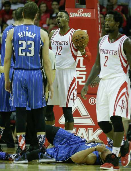 Dwight Howard (12) complains about a flagrant foul for roughing up the Magic's Aaron Gordon, bottom. Photo: Brett Coomer, Staff / © 2015 Houston Chronicle