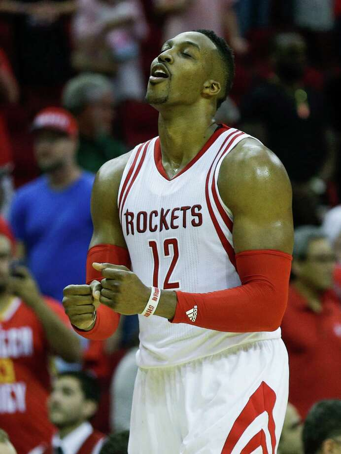 With a Rockets victory finally a given as overtime winds down Wednesday night, center Dwight Howard leaves the floor at Toyota Center feeling like a winner at last. He contributed 23 points and 14 rebounds. Photo: Brett Coomer, Staff / © 2015 Houston Chronicle