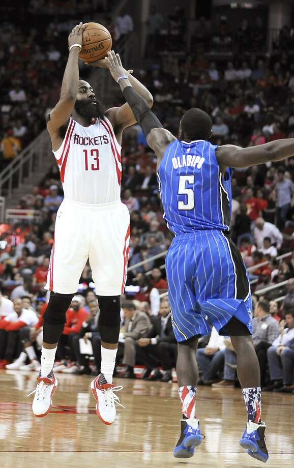 Houston Rockets' James Harden (13) shoots over Orlando Magic's Victor Oladipo (5) during the second half of an NBA basketball game Wednesday, Nov. 4, 2015, in Houston. The Rockets won in overtime 119-114. (AP Photo/Pat Sullivan) Photo: Pat Sullivan, Associated Press