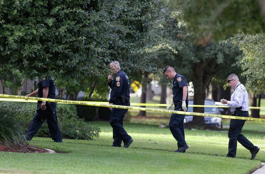 Police are shown at the scene where an elderly man apparently shot and killed his wife and injured two others before fatally shooting himself at his home in the 20300 block of Silverwood Trail Wednesday, Nov. 4, 2015, in Cypress. ( Melissa Phillip  / Houston Chronicle ) Photo: Melissa Phillip, Staff / © 2015 Houston Chronicle