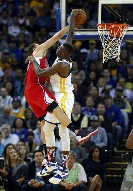 Golden State Warriors' Festus Ezeli blocks a dunk attempt by Los Angeles Clippers' Blake Griffin in 1st quarter during NBA game at Oracle Arena in Oakland, Calif., on Wednesday, November 4, 2015.