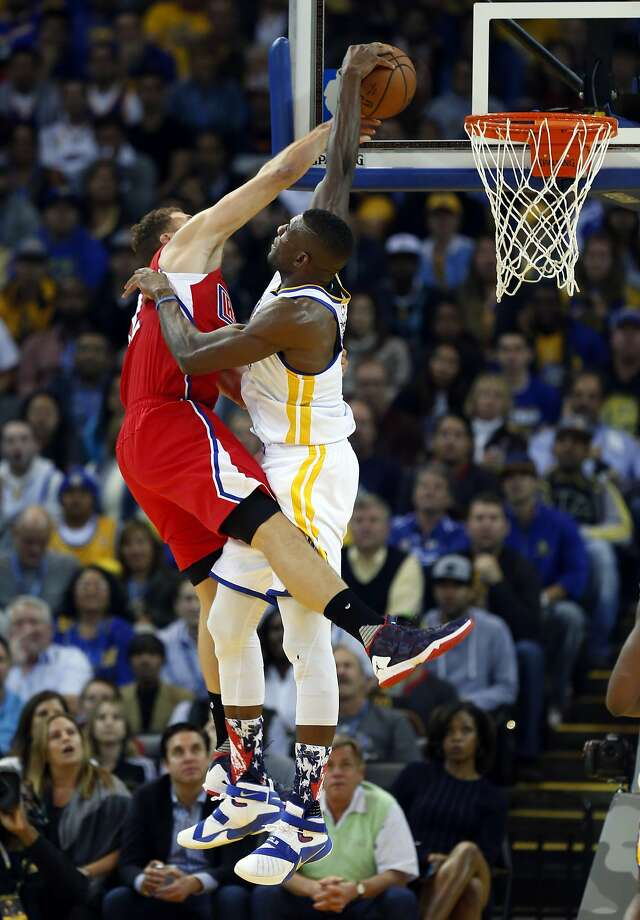 Golden State Warriors' Festus Ezeli blocks a dunk attempt by Los Angeles Clippers' Blake Griffin in 1st quarter during NBA game at Oracle Arena in Oakland, Calif., on Wednesday, November 4, 2015. Photo: Scott Strazzante, The Chronicle