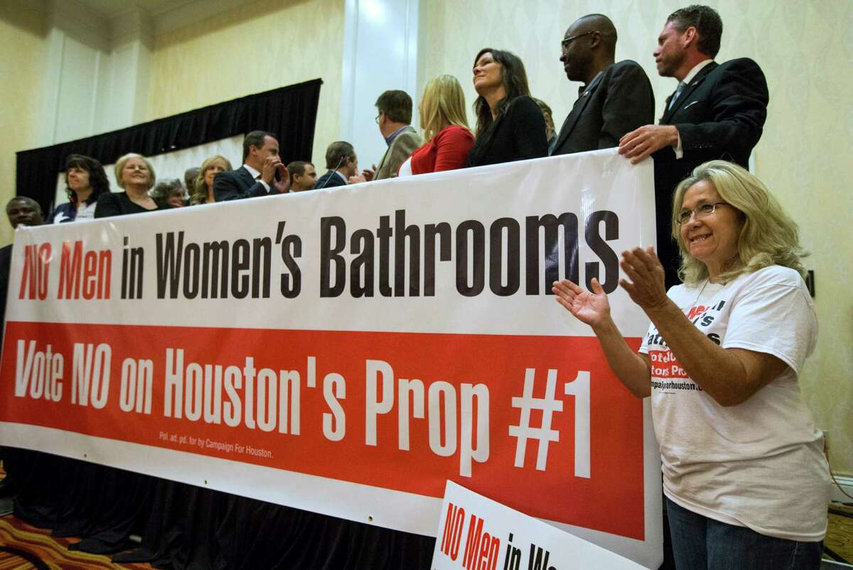 Rita Palomarez, right, cheers as voting results are announced during an election watch party attended by opponents of the Houston Equal Rights Ordinance on Tuesday, Nov. 3, 2015, in Houston.