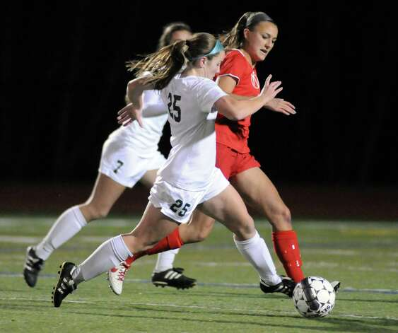 Shen's Meghan Cavanaugh and Niskayuna's Marika Contompasis battle for the ball during their girls' soccer Section II Class AA championship game on Wednesday Nov. 4, 2015 in Stillwater, N.Y.  (Michael P. Farrell/Times Union) Photo: Michael P. Farrell / 00034069A