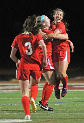 Niskayuna's Isabelle Lynch, right, is congratulated by teammates after scoring a goal during their girls' soccer Section II Class AA championship game against Shenendehowa on Wednesday Nov. 4, 2015 in Stillwater, N.Y.  (Michael P. Farrell/Times Union) Photo: Michael P. Farrell / 00034069A