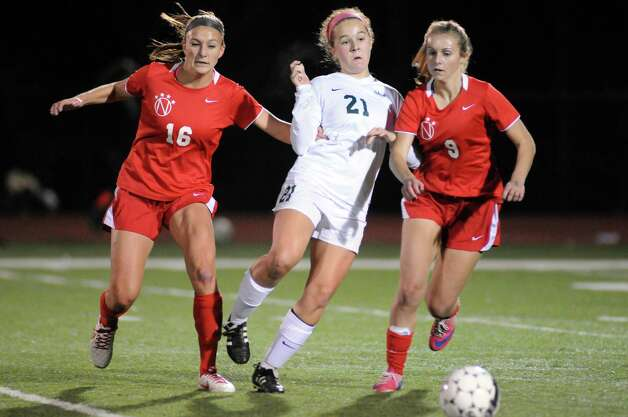 Niskayuna's Marika Contompasis, left, and Hannah McPartlon, right, battle Shen's Emma Smith for the ball during their girls' soccer Section II Class AA championship game against on Wednesday Nov. 4, 2015 in Stillwater, N.Y.  (Michael P. Farrell/Times Union) Photo: Michael P. Farrell / 00034069A