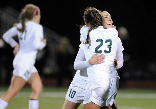 Shen's Amanda Volk gives teammate Katherine Frain a hug after frain scored a goal during their girls' soccer Section II Class AA championship game against Niskayuna on Wednesday Nov. 4, 2015 in Stillwater, N.Y.  (Michael P. Farrell/Times Union) Photo: Michael P. Farrell / 00034069A