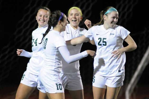 Shen's Meghan Cavanaugh, right, is congratulated by teammates after scoring a goal during their girls' soccer Section II Class AA championship game against Niskayuna on Wednesday Nov. 4, 2015 in Stillwater, N.Y.  (Michael P. Farrell/Times Union) Photo: Michael P. Farrell / 00034069A