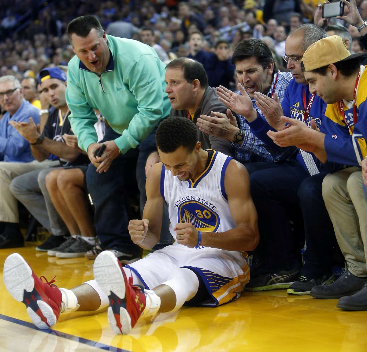 Golden State Warriors' Stephen Curry reacts to being fouled while shooting a 3-pointer against Los Angeles Clippers in 2nd quarter during NBA game at Oracle Arena in Oakland, Calif., on Wednesday, November 4, 2015.