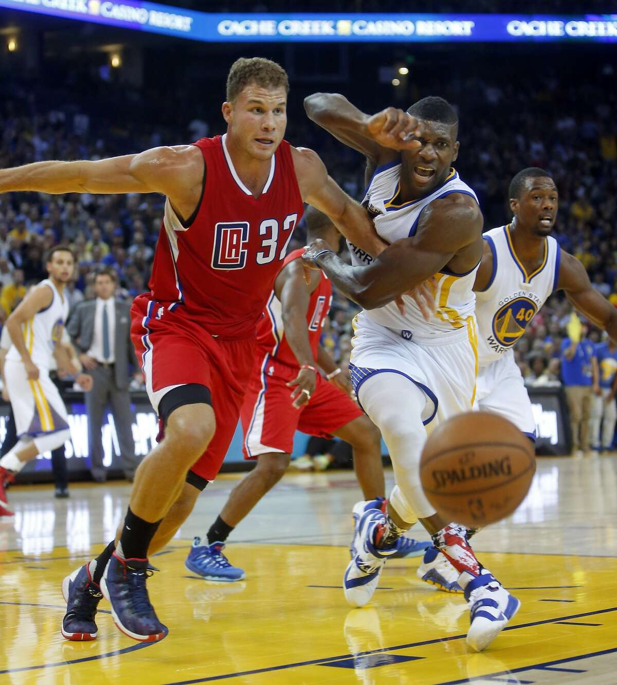 Los Angeles Clippers' Blake Griffin keeps Golden State Warriors' Festus Ezeli from getting to a loose ball in 2nd quarter during NBA game at Oracle Arena in Oakland, Calif., on Wednesday, November 4, 2015.