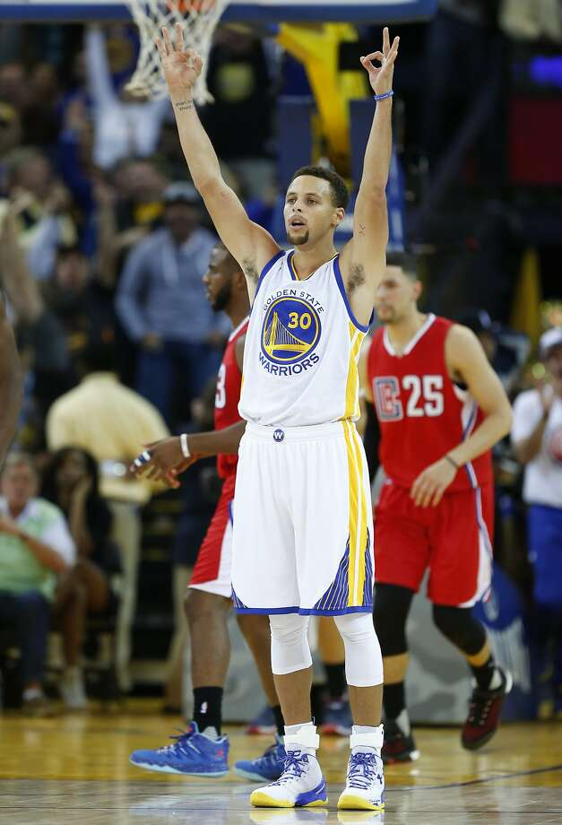 Golden State Warriors' Stephen Curry celebrates one of his 4th quarter 3-pointers against Los Angeles Clippers during Warriors' 112-108 win in NBA game at Oracle Arena in Oakland, Calif., on Wednesday, November 4, 2015. Photo: Scott Strazzante, The Chronicle