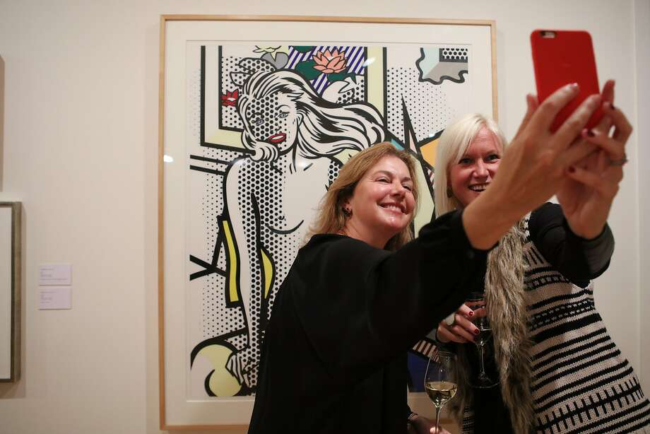 """Karen Berniker (center) and Patricia Wyrod take a selfie in front of Roy Lichtenstein's """"Nude With Yellow Pillow"""" at the John Berggruen Gallery in S.F. Photo: Gabrielle Lurie, Special To The Chronicle"""