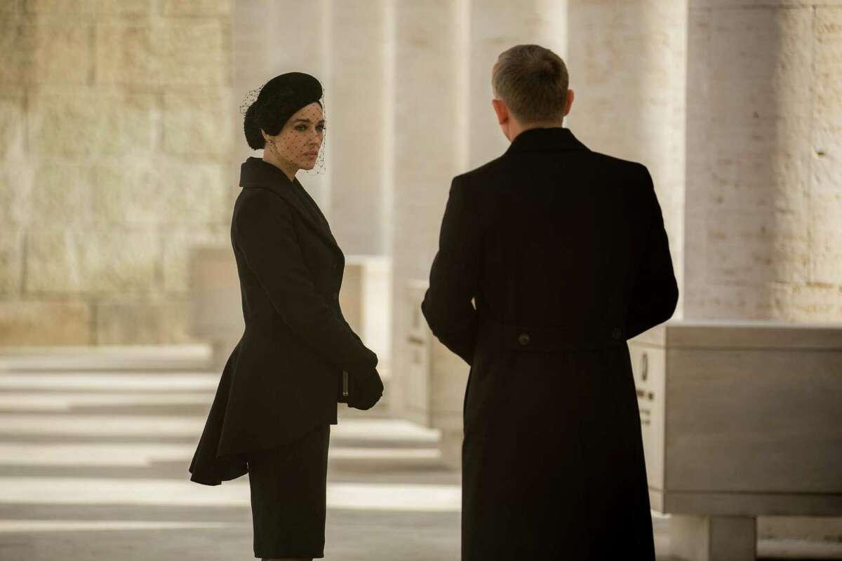 In this image released by Metro-Goldwyn-Mayer Pictures/Columbia Pictures/EON Productions, Monica Bellucci, left, and Daniel Craig appear in a scene from the James Bond film,